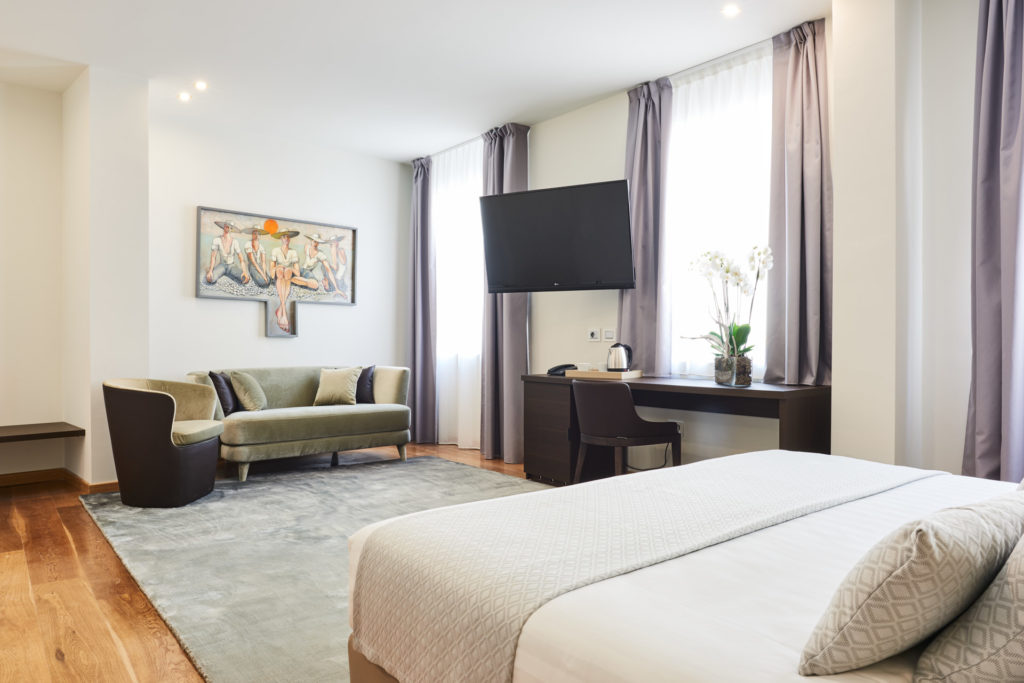 interni delle camere Junior Suite dell'Hotel Michelangelo Carrara